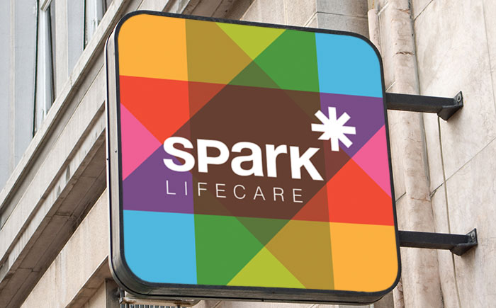 Signage by Ottawa Graphic Designer idApostle for Services Company Spark Lifecare
