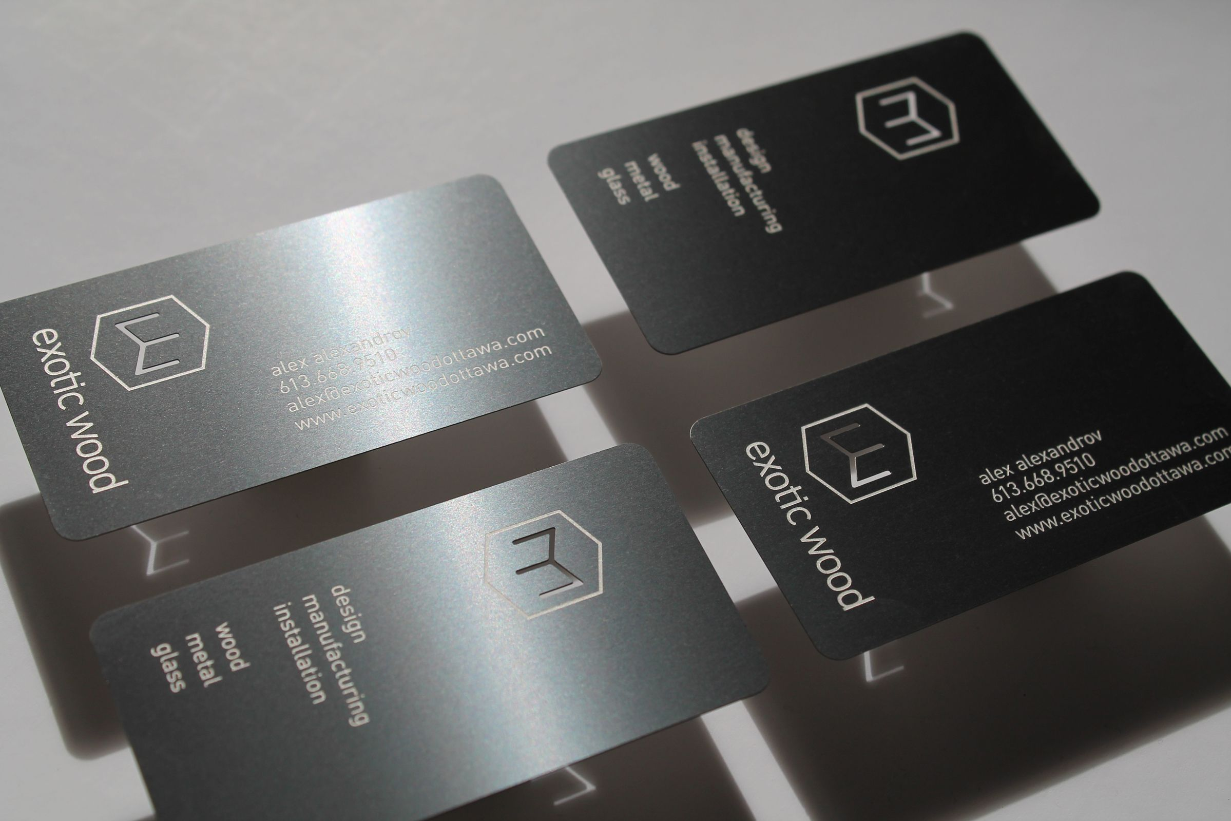 Metal business card for Exotic Wood, an Ottawa furniture manufacturer, by Graphic Design Studio idApostle