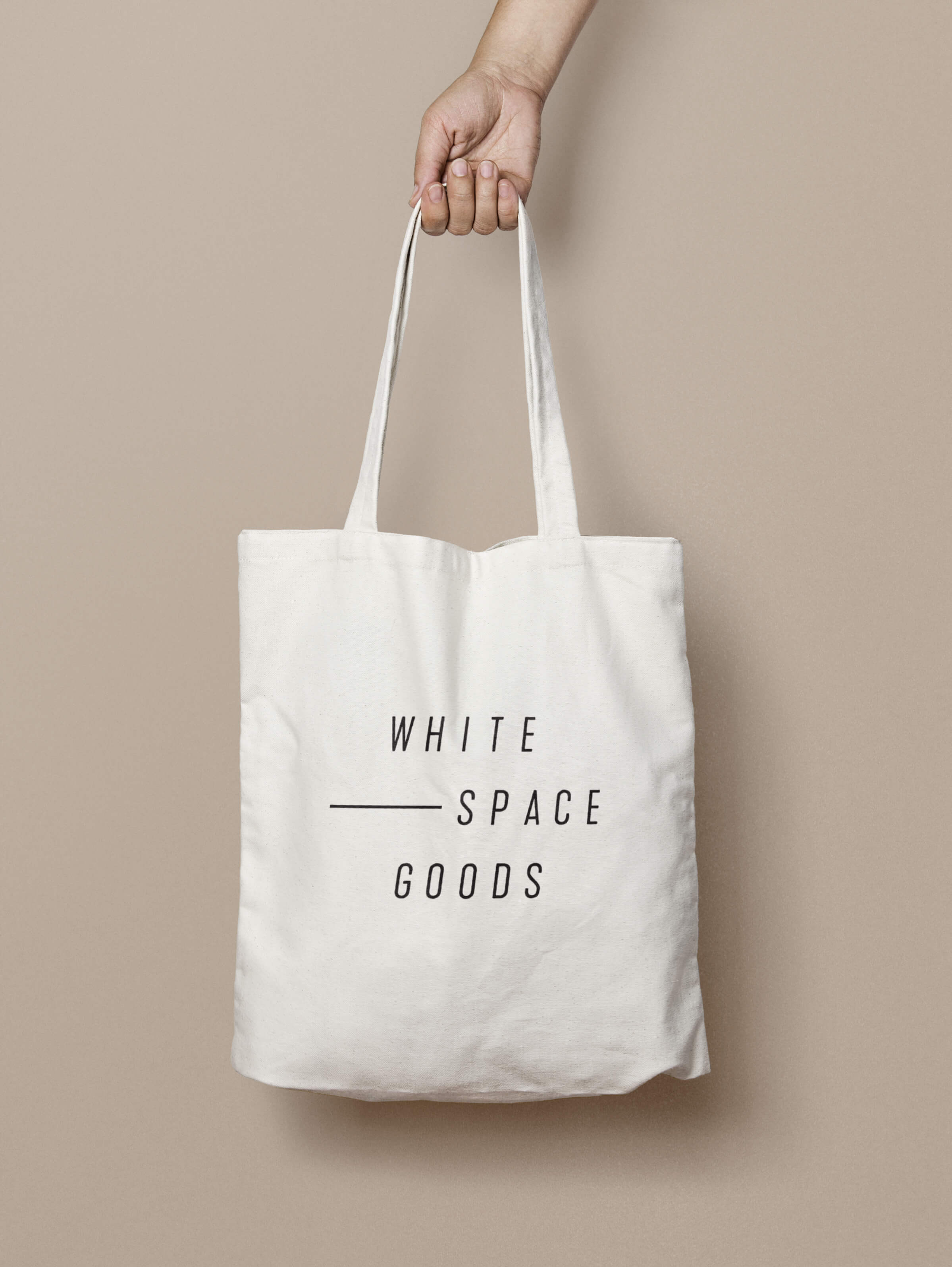Whitespace Goods shopping bag for Ottawa-based handmade knitware and decor by graphic designer idApostle