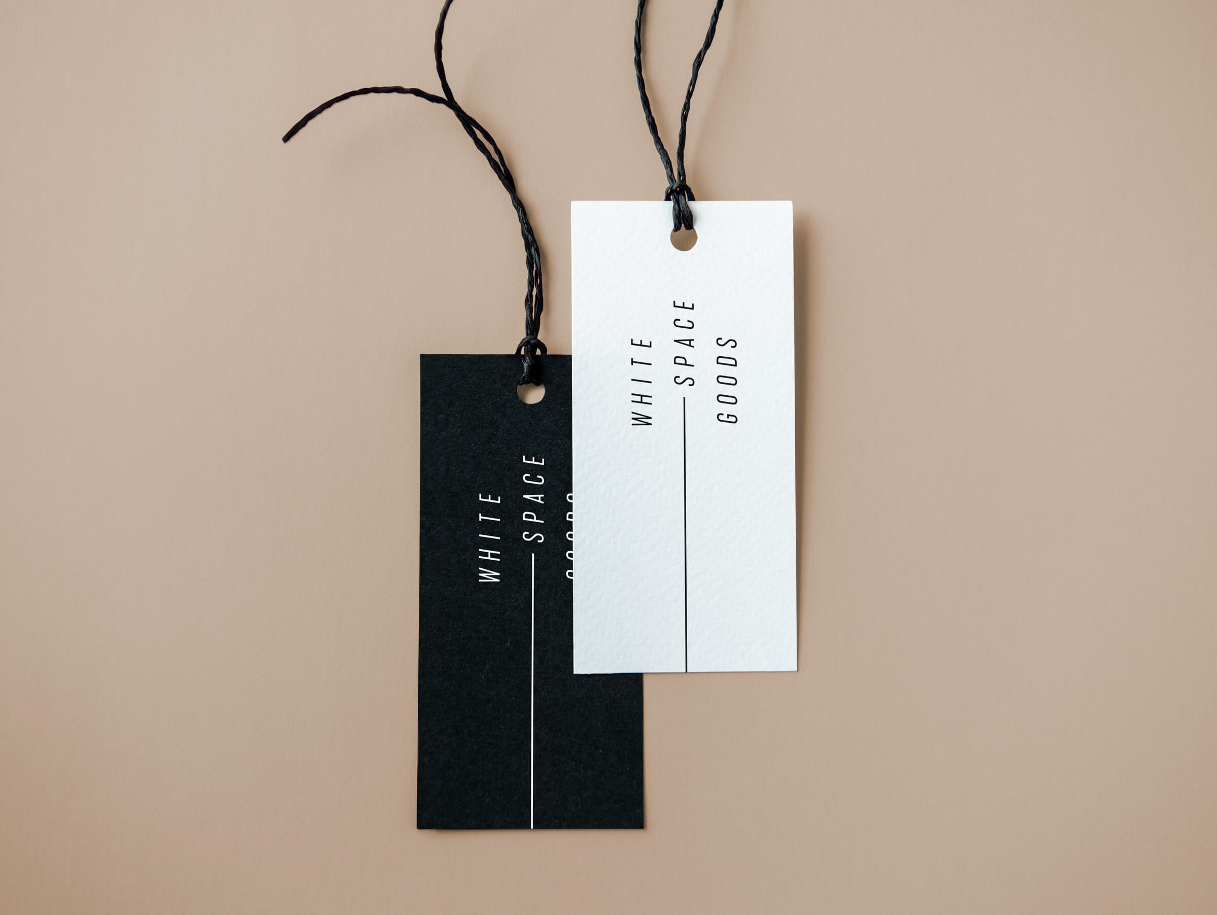Whitespace Goods clothing tag for Ottawa-based handmade knitware and decor by graphic designer idApostle